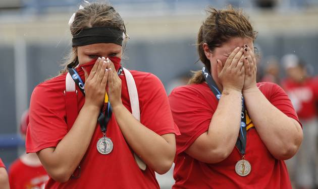 Dale's Sam Barry and McKenzie Stith, from left, react after the loss to Tushka in the Class 4A Oklahoma State High School Slow Pitch Softball Championship at ASA Hall of Fame Stadium in Oklahoma City, Wednesday, May 1, 2013. Photo by Chris Landsberger, The Oklahoman