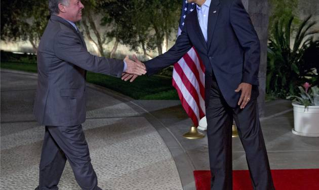 President Barack Obama, right, greets Jordan's King Abdullah II at The Annenberg Retreat at Sunnylands, Rancho Mirage, Calif., Friday, Feb. 14, 2014. (AP Photo/Jacquelyn Martin)