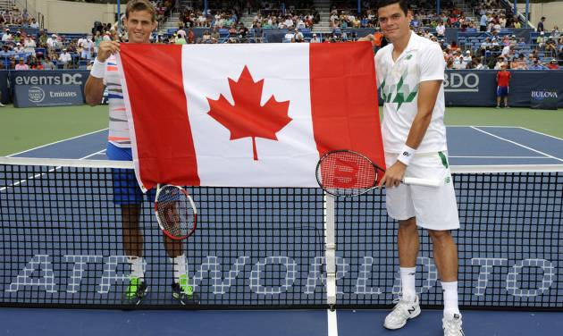 Vasek Pospisil, left, and Milos Raonic, right, both of Canada, pose before the men's singles final at the Citi Open tennis tournament, Sunday, Aug. 3, 2014, in Washington. Raonic won 6-1, 6-4. (AP Photo/Nick Wass)