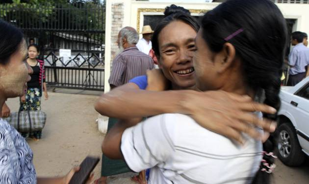 A Myanmar prisoner, center, is welcomed by her relative outside Insein prison in Yangon, Myanmar after the political prisoners were released Thursday, Nov. 15, 2012. Myanmar reformist government ordered more than 450 prisoners freed Thursday in an amnesty apparently intended as a goodwill gesture ahead of an historic visit by President Barack Obama next week. (AP Photo/Khin Maung Win)