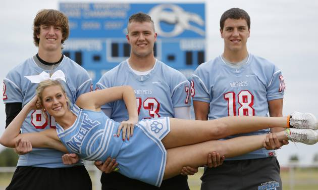 Okeene quadruplets, from left, Mikey, Jamie and Scott Dobrinski hold their sister Shelby in Okeene, Wednesday October 16, 2013. Shelby is a cheerleader and her brothers play football. Photo By Steve Gooch, The Oklahoman