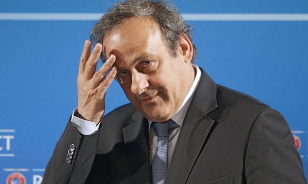 """FILE - In this Feb.22, 2014 file photo, UEFA President Michel Platini arrives at a press conference, one day prior to the UEFA EURO 2016 qualifying draw in Nice, southeastern France. Michel Platini will not challenge Sepp Blatter for the FIFA presidency, saying Thursday Aug.28, 2014  there was """"no shadow of doubt"""" about his decision. The former France great was expected to avoid a contest against Blatter after a successful World Cup strengthened the FIFA president's position. (AP Photo/Lionel Cironneau, File)"""