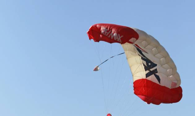 A parachute jumper carrying the Texas state flag descends on the track before the NASCAR Sprint Cup Series auto race at Texas Motor Speedway, Sunday, Nov. 4, 2012, in Fort Worth, Texas. The weight used to balance the flag fell into Kevin Harvick's No. 29 car. (AP Photo/The Fort Worth Star-Telegram, Rodger Mallison) MAGS OUT; (FORT WORTH WEEKLY, 360 WEST)