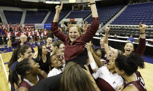Fordham head coach Stephanie Gaitley is lifted up by her team after they won the A10 Women's basketball championship game in Richmond, Va., Sunday, March 9, 2014. Fordham defeated Dayton 63-51. (AP Photo/Steve Helber)