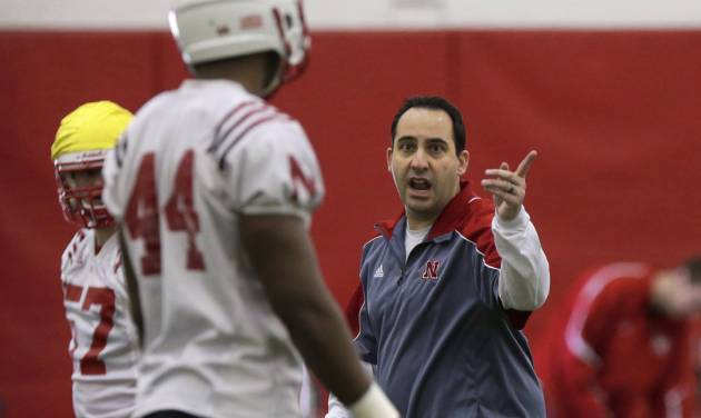 Nebraska defensive coordinator John Papuchis talks to defensive end Randy Gregory (44) on the first day of spring NCAA college football practice in Lincoln, Neb., Saturday, March 8, 2014. (AP Photo/Nati Harnik)