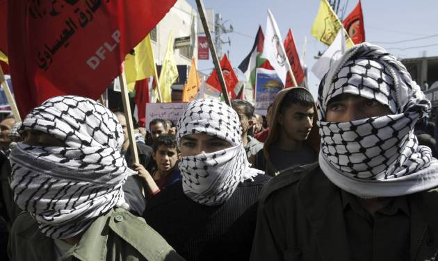 Men march in support of the Palestinian prisoners,  in the West Bank city of Jenin, Tuesday, Feb. 26, 2013. Palestinians have been staging support rallies for nearly 4,600 prisoners held by Israel, particularly for four inmates who have been on extended hunger strikes. (AP Photo/Mohammed Ballas)