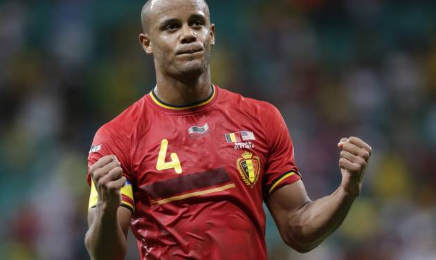 Belgium's Vincent Kompany celebrates after the World Cup round of 16 soccer match between Belgium and the USA at the Arena Fonte Nova in Salvador, Brazil, Tuesday, July 1, 2014. Belgium won the match 2-1 after extra-time. (AP Photo/Julio Cortez)