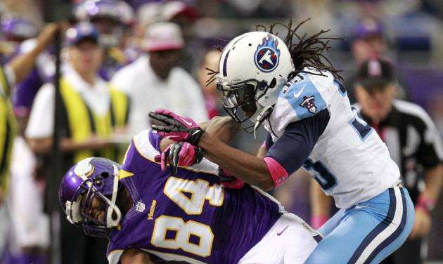 Tennessee Titans safety Michael Griffin, right, breaks up a pass intended for Minnesota Vikings wide receiver Michael Jenkins (84) during the first half of an NFL football game on Sunday, Oct. 7, 2012, in Minneapolis. (AP Photo/Genevieve Ross)