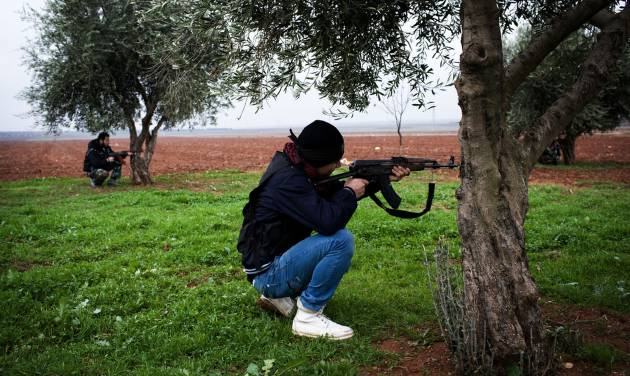 Free Syrian Army fighters aim their weapons, close to a military base, near Azaz, Syria, Monday, Dec. 10, 2012. The gains by rebel forces came as the European Union denounced the Syrian conflict, which activists say has killed more than 40,000 people. (AP Photo/Manu Brabo)