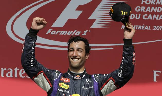 Red Bull driver Daniel Ricciardo, from Australia, celebrates after winning the Canadian Grand Prix Sunday, June 8, 2014, in Montreal. (AP Photo/David J. Phillip)