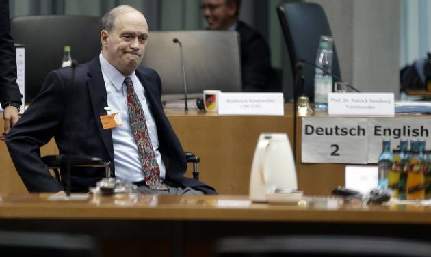 The former  US National Security Agency, NSA, employee William Binney, in wheelchair, arrives for his questioning by the German parliamentary NSA investigation committee in Berlin, Germany, Thursday, July 3, 2014. Picture taken trough a window. The committee investigates  the NSA  surveillance  activities, that also included the tapping of German Chancellor Angela Merkel. (AP Photo/Michael Sohn)