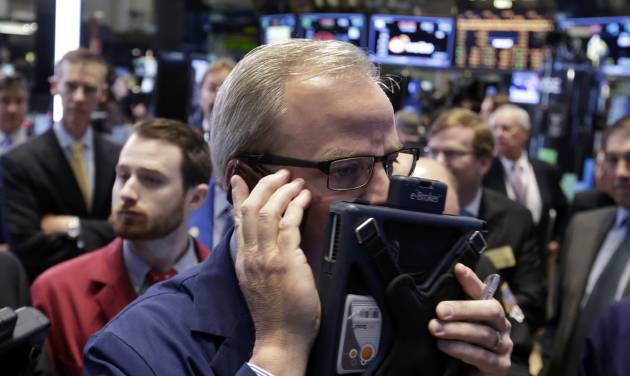 FILE - In this Friday, May 2, 2014 file photo, trader David O'Day works on the floor of the New York Stock Exchange. U.S. stock futures are trading lower as investors await comments from Federal Reserve Chair Janet Yellen, scheduled to address Congress on the economy. A new report Tuesday, May 6, 2014, shows that housing prices rose in March, but at a slower pace than a month earlier. (AP Photo/Richard Drew, File)