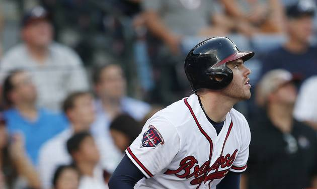 Atlanta Braves first baseman Freddie Freeman (5) follows through on a three-run home run in the second inning of baseball game against the Miami Marlins  in Atlanta, Wednesday, July 23, 2014. (AP Photo)