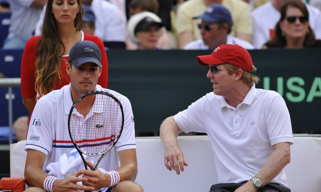 John Isner of US, left, listens to his Davis Cup manager Jim Courier during the Davis Cup World Group semifinal tennis match against Spain's David Ferrer, in Gijon, northern Spain, Sunday, Sept. 16, 2012. Ferrer won 6-7, 6-3, 6-4, 6-2. (AP Photo/Alvaro Barrientos)