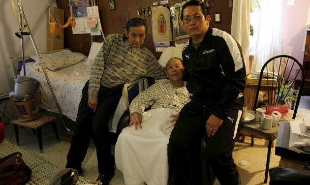 In this photo taken Saturday, Nov. 17, 2012, Juan Chiu Trujillo, center, a Chinese Mexican poses with his sons; Juan Chiu Chan, left, and Ignacio Chiu Chan, during an interview in Mexico City. Chiu who was born in Mexico, was among thousands of Chinese Mexicans expelled when Mexico erupted into xenophobia fueled by the economic turmoil of the Great Depression. Chiu returned in 1960, along with 300 other Chinese-Mexicans, after President Adolfo Lopez Mateos paid for their travel expenses and decreed that they would be legally allowed to live in Mexico. Dozens of those Chinese-Mexicans and their descendants gather Saturday, Nov. 24, 2012, at a Chinese restaurant in central Mexico City to celebrate the anniversary of their return. (AP Photo/Marco Ugarte)
