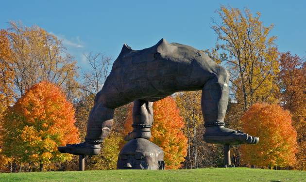 """This undated image provided by Storm King Art Center in New Windsor, N.Y., shows """"Three-Legged Buddha"""" by Zhang Huan, one of more than 100 outdoor sculptures at the unique art park set amid rolling hills and fields in the Hudson Valley, just north of New York City. It's one of a number of destinations in the region, and autumn is a particularly nice time of year to visit. (AP Photo/Storm King Art Center)"""