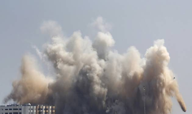Smoke, dust and debris rise over Gaza City after an Israeli strike, Friday, Aug. 8, 2014, as Israel and Gaza militants resumed cross-border attacks after a three-day truce expired and Egyptian-brokered talks on a new border deal for blockaded Gaza hit a deadlock. (AP Photo/Hatem Moussa)