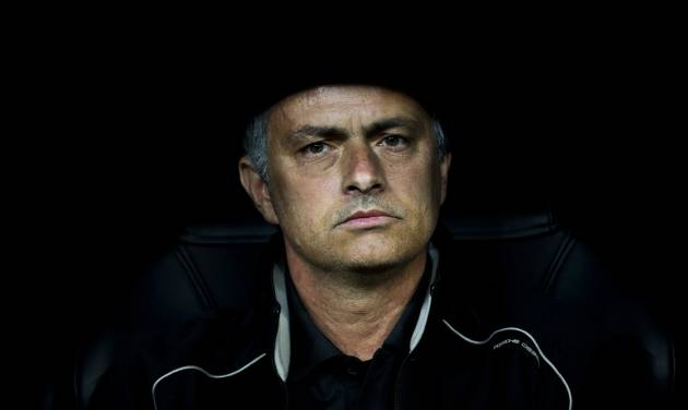FILE - In this Wednesday, March 14, 2012 file photo Real Madrid's coach Jose Mourinho from Portugal looks on before a Champions League round of 16, second leg soccer match against CSKA Moscow's at the Santiago Bernabeu Stadium, in Madrid. Real Madrid says Monday May 20, 2013, coach Jose Mourinho will leave at end of season. (AP Photo/Daniel Ochoa de Olza, File)