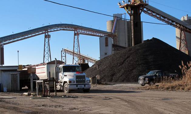 FILE - In this Dec. 26, 2013 file photo a coal truck is loaded with another payload at the Crown III underground coal mine near Farmersville, Ill. The Federal Reserve reports on the country's industrial production for December on Friday, Jan. 17, 2014. (AP Photo/Jim Suhr)