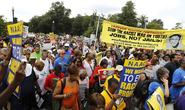 """Participants march down Independence Avenue away from the Lincoln Memorial during the rally to commemorate the 50th anniversary of the 1963 March on Washington Saturday, Aug. 24, 2013, in Washington. Tens of thousands of people marched to the Martin Luther King Jr. Memorial and down the National Mall on Saturday, to commemorate King's famous """"""""I Have a Dream"""" speech, made Aug. 28, 1963, during the March on Washington, and pledging that his dream includes equality for gays, Latinos, the poor and the disabled. (AP Photo/Jose Luis Magana)"""