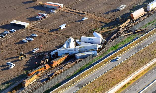 This aerial photo shows the scene where three freight trains collided near Amarillo, Texas on Wednesday, Sept. 25, 2013. An eastbound BNSF Railway train rear-ended a stopped train, derailing up to 30 cars and injuring four crewmembers including two critically. (AP Photo/The Amarillo Globe News, Michael Schumacher)