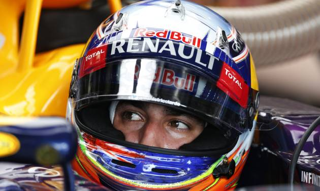 Australia's Daniel Ricciardo of Red Bull sits in his car at the pits during a practice session in Silverstone, England, on Friday, July 4, 2014, ahead of this weekend's Formula One British Grand Prix.The British Formula One Grand Prix will be held on Sunday July 6, 2014. (AP Photo/Lefteris Pitarakis)