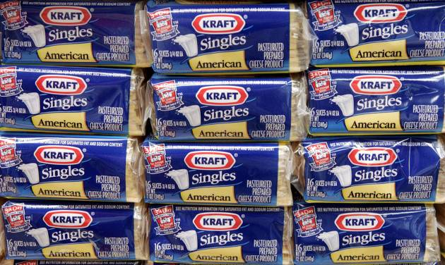 FILE - In this July 24, 2006, file photo,  packages of Kraft Singles are displayed in Chicago.  Kraft is removing artificial preservatives from its most popular individually wrapped cheese slices, in the latest sign that companies are tweaking recipes as food labels come under greater scrutiny. (AP Photo/Charles Rex Arbogast, file)