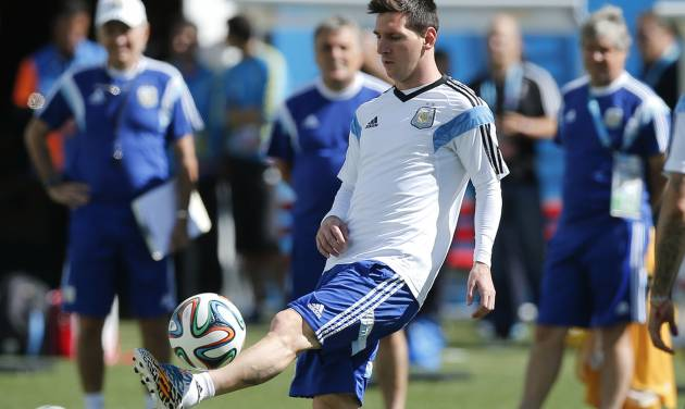 Argentina's Lionel Messi controls the ball during a training session at Itaquerao Stadium in Sao Paulo, Brazil, Monday, June 30, 2014. On Tuesday, Argentina will face Switzerland in their next World Cup soccer match.  (AP Photo/Victor R. Caivano)