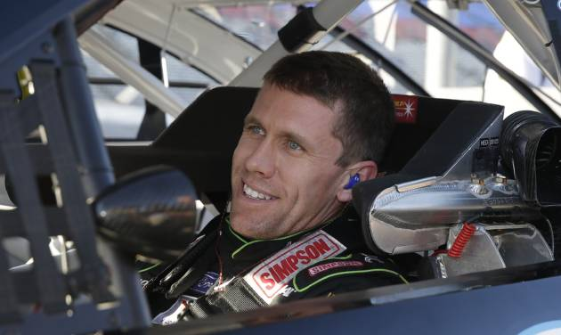 Driver Carl Edwards smiles after he took the pole for Sunday's NASCAR Sprint Cup series auto race at the Texas Motor Speedway in Fort Worth, Texas, Friday, Nov. 1, 2013.  (AP Photo/LM Otero)