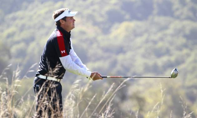 Jeff Overton tees off on the 14th hole during the first round of the Frys.com Open golf tournament at the CordeValle golf course in San Martin, Calif., on Thursday, Oct. 10, 2013. (AP Photo/San Jose Mercury News, (Patrick Tehan)  MAGS OUT; NO SALES