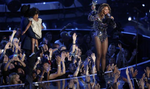 Beyonce accepts the Video Vanguard Award with Blue Ivy and Jay-Z at left during the MTV Video Music Awards at The Forum on Sunday, Aug. 24, 2014, in Inglewood, Calif. (Photo by Matt Sayles/Invision/AP)