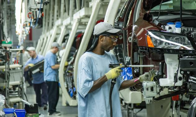 FILE - In this June 12, 2013, file photo, workers assemble Volkswagen Passat sedans at the German automaker's plant in Chattanooga, Tenn.  Workers at Volkswagen's only U.S. factory will decide in February 2014 whether to be represented by the United Auto Workers union.(AP Photo/ Erik Schelzig, file)