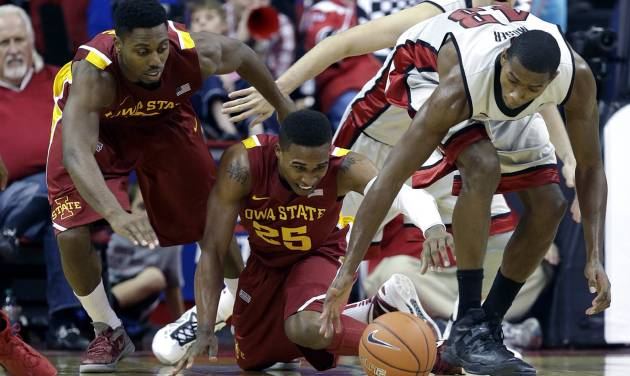 Iowa State's Melvin Ejim, left, Tyrus McGee, center, and UNLV's Mike Moser, right, reach for the loose ball during the second half of an NCAA college basketball game, Saturday, Nov. 24, 2012, in Las Vegas. UNLV won 82-70. (AP Photo/Julie Jacobson)