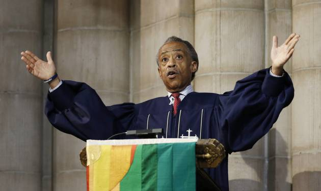 The Rev. Al Sharpton gestures as he addresses the congregation, Sunday, July 20, 2014, at Manhattan's Riverside Church in New York.  Sharpton demanded justice for the apparent police chokehold death of Eric Garner, who died three days ago in Staten Island.  He also said that citizens who kill police officers should be held accountable. (AP Photo/Kathy Willens)