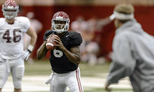 Alabama quarterback Blake Sims (6) works through passing drills during Alabama football practice, Tuesday, August 26, 2014, at the Hank Crisp Indoor Facility in Tuscaloosa, Ala.   (AP Photo/AL.com, Vasha Hunt) MAGS OUT   MANDATORY CREDIT