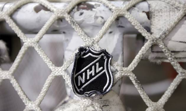 The NHL logo is seen on a goal at a Nashville Predators practice rink on Monday, Sept. 17, 2012, in Nashville, Tenn. The NHL locked out its players at midnight Saturday, the fourth shutdown for the NHL since 1992. (AP Photo/Mark Humphrey)