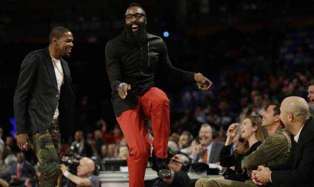 Houston Rockets James Harden, right, dances with Oklahoma City Thunder Kevin Durant during the Rising Star NBA All Star Challenge Basketball game, Friday, Feb. 14, 2014, in New Orleans. (AP Photo/Gerald Herbert)