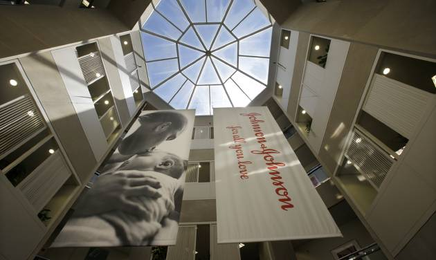 In this Tuesday, July 30, 2013, photo, large banners hang in an atrium at the headquarters of Johnson & Johnson in New Brunswick, N.J. Johnson & Johnson reports quarterly financial results before the market opens on Tuesday, Jan. 21, 2014. (AP Photo/Mel Evans)