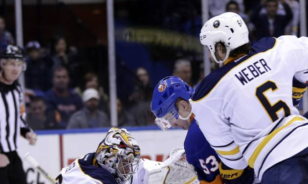 Buffalo Sabres goalie Ryan Miller, left, defends against a shot by New York Islanders' Casey Cizikas, center, while Mike Weber looks on during the second period of the NHL hockey game Saturday, Feb. 9, 2013, in Uniondale, N.Y. (AP Photo/Seth Wenig)