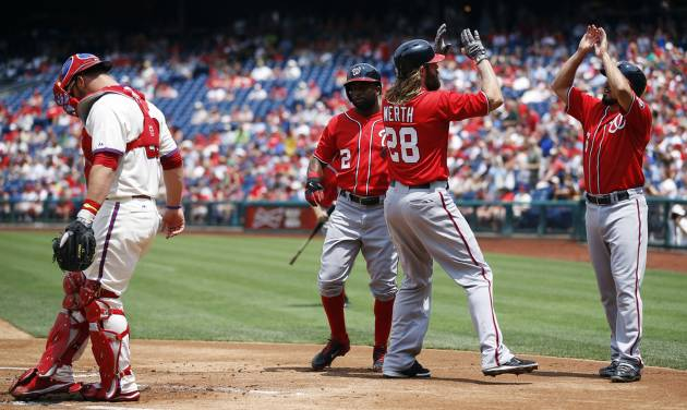 Washington Nationals' Anthony Rendon, from right, Jayson Werth, center, and Denard Span, left, celebrate behind Philadelphia Phillies catcher Cameron Rupp after Werth's three-run home run during the first inning of a baseball game, Sunday, July 13, 2014, in Philadelphia. (AP Photo/Matt Slocum)
