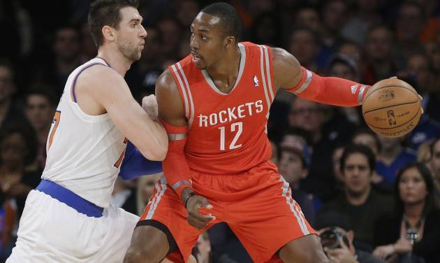 New York Knicks' Andrea Bargnani, left, of Italy, defends Houston Rockets' Dwight Howard during the first half of an NBA basketball game Thursday, Nov. 14, 2013, in New York. (AP Photo/Frank Franklin II)