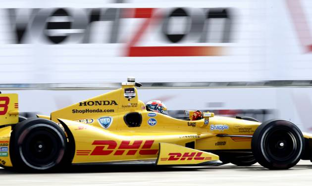 Ryan Hunter-Reay drives through the course during a practice session for the IndyCar Grand Prix of Houston auto race Friday, June 27, 2014, in Houston. (AP Photo/Juan DeLeon)