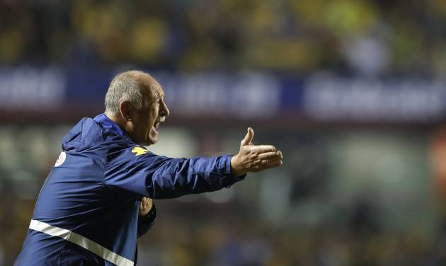 Brazil's Luiz Felipe Scolari coaches during a friendly soccer match against Serbia at the Morumbi stadium in Sao Paulo, Brazil, Friday, June 6, 2014. Brazil is hosting the World Cup soccer tournament that starts June 12. (AP Photo/Andre Penner)