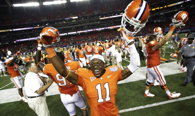 Clemson players including safety Travis Blanks (11) celebrate a 26-19 win over Auburn in a NCAA college football game at the Georgia Dome in Atlanta Saturday, Sept. 1, 2012. (AP Photo/Dave Martin)