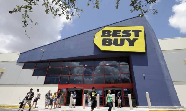 FILE - In this Monday, Aug. 19, 2013 file photo, shoppers walk toward the parking lot at a Best Buy store in Hialeah, Fla. On Thursday, Feb. 27, 2014, Best Buy reports quarterly earnings. (AP Photo/Alan Diaz, File)