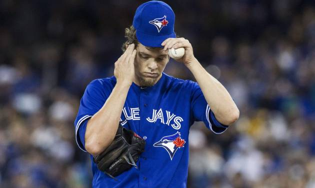 Toronto Blue Jays starting pitcher Josh Johnson reacts as he works against New York Yankees during first inning of an MLB American League baseball action in Toronto on Sunday, April 21, 2013. (AP Photo\THE CANADIAN PRESS,Chris Young) ORG XMIT: CHY105