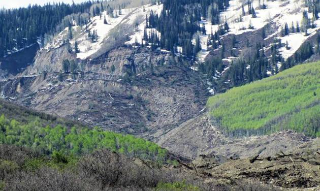 The results of a three-mile long mudslide appear on Grand Mesa, where the slide started, in a remote part of western Colorado near the small town of Collbran Monday, May 26, 2014. Rescue teams are searching for three men missing after a half-mile stretch of a ridge saturated with rain collapsed.(AP Photo/Mesa County Sheriff's Office)