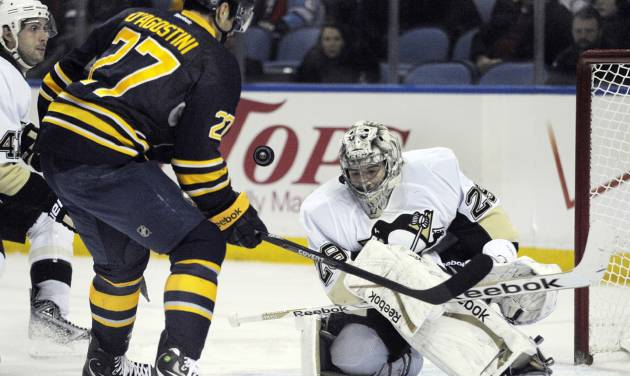 Buffalo Sabres'  Matt D'Agostini (27) shoots the puck at Pittsburgh Penguins' Marc-Andre Fleury during the first period of an NHL hockey game in Buffalo, N.Y., Wednesday, Feb. 5,  2014. (AP Photo/Gary Wiepert)