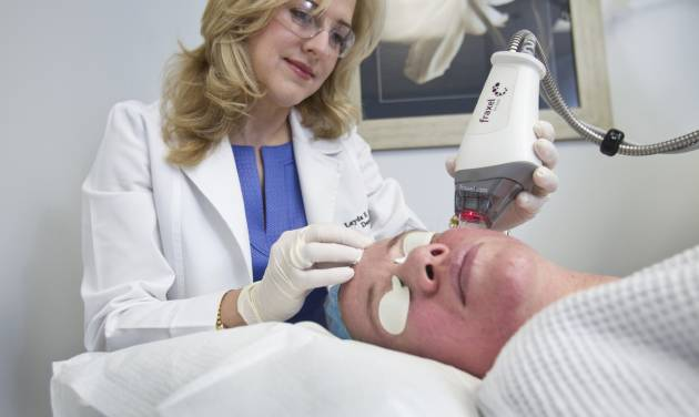 Dr. Leyda E. Bowens performs a Fraxel Laser treatment for wrinkles. (C.W. Griffin/Miami Herald/MCT)