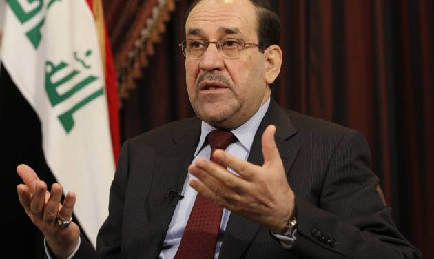 FILE - In this Dec. 3, 2011, file photo, Iraq's Shiite Prime Minister Nouri al-Maliki talks during an interview with The Associated Press in Baghdad, Iraq. As a Sunni Muslim insurgency gains ground in Iraq, the United States is pondering whether the violent march could be slowed with new leadership in Baghdad after years of divisive policies. But with no obvious replacement for al-Maliki, and no apparent intent on his part to step down, Washington is largely resigned to continue working with him for a third term as Iraq's premier.  (AP Photo/Hadi Mizban, File)
